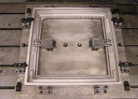 Large Aluminum casting held is custom fixture. Machined on a CNC vertical machining center