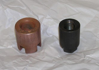 Both parts are 4140 steel nuts that are heat treated to 48 Rc and one is copper electroplated.